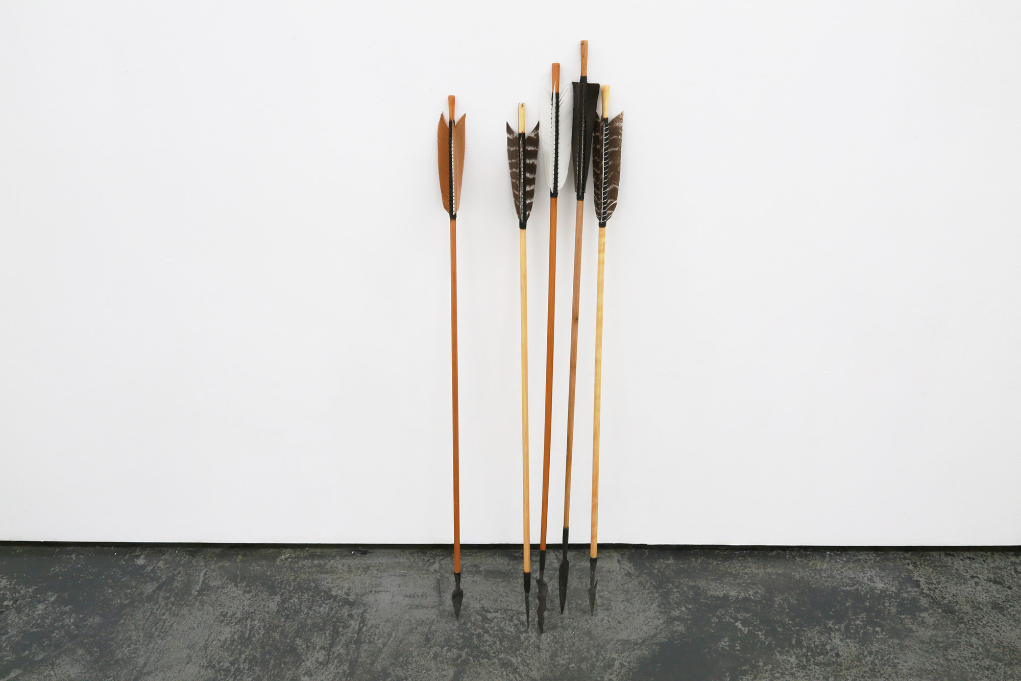 Christian Bang Jensen, Aimlessly Floating Through Space, 2016, meteorite iron, wood, feathers, tar, arrowheads made by viking smith, arrows made by medieval fletcher, Variable dimensions